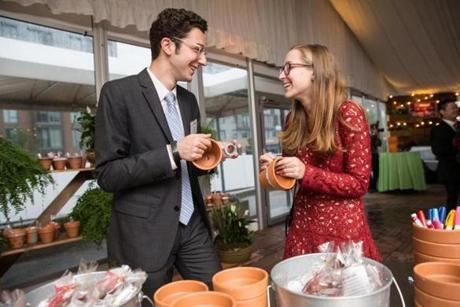 05/25/2017 BOSTON, MA Nathan Rosin (cq) (left) and Emily Lavine (cq) make community garden pots at the City Year annual Starry Night Gala at the Westin Boston Waterfront. (Aram Boghosian for The Boston Globe)