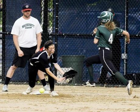 Milford second baseman Madison Bovino, covering first base, bobbles a bad throw as Wachusetts' Courtney Lanpher reaches safely.