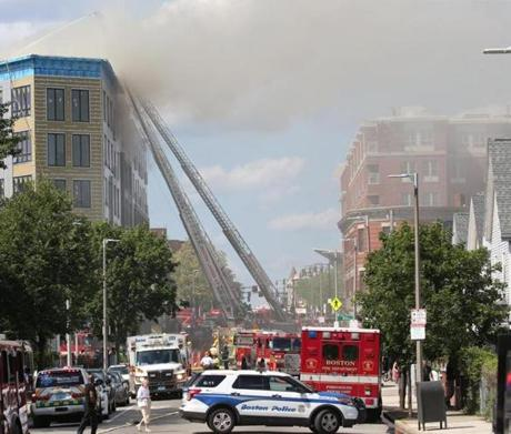 Massive fire rips through building under construction in Dorchester