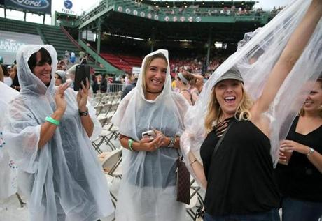 Fans donned ponchos at the concert.