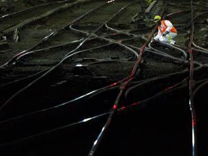 A worker inspected some of the tracks leading into and out of Penn Station.