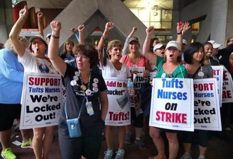 Boston-07/13/2017- Tufts Medical Center nurses are locked out of their jobs after they ended their 24-hour strike but continue to picket at 7a.m. They cheer from across the street of the main entrance. John Tlumacki/The Boston Globe(metro)