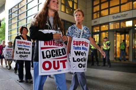 Boston-07/13/2017- Tufts Medical Center nurses are locked out of their jobs after they ended their 24-hour strike but continue to picket after 7a.m. John Tlumacki/The Boston Globe(metro)