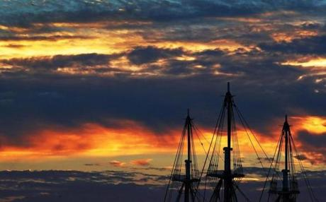 The masts of the USS Constitution at sunset.