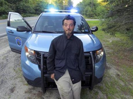 This Tuesday, July 25, 2017, photo released by the Maine State Police shows Corey Berry, 31, of Hollis, Maine, arrested and charged with criminal threatening after police said he was found strolling down a street wearing a clown mask with a machete taped to his amputated arm. He was released after posting bail. (Maine State Police via AP)
