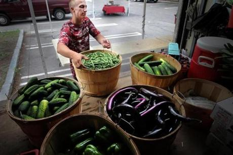 Brookline, MA - 07/27/17 - Kevin Bragg of Kimball Fruit Farm (cq) unloads produce at the Brookline Farmers Market in Coolidge Corner. The number of farmers markets has grown by about 300 percent in the past ten years. There are more customers, too--but not 300 percent more. In many cases that means fewer customers per market, and less business for the farmers who work very hard to get their produce or meat or eggs to the markets. Some farmers are dropping markets, others are adding markets to make up the business. (Lane Turner/Globe Staff) Reporter: (Beth Teitell Mandl) Topic: (29farmers)