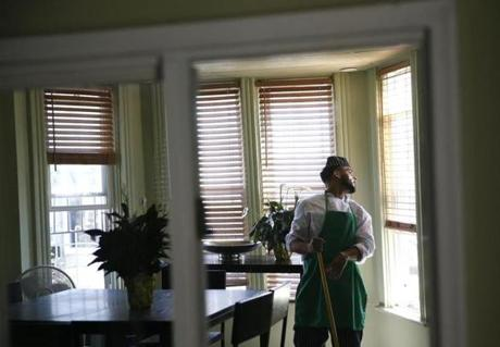 Snapchef student Zeke Tejada, of Dorchester, leans back to looked out of the window as he helps to clean up after .