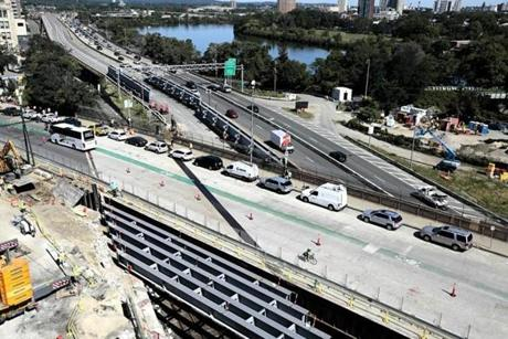 Traffic was reduced to two lanes each way on the Pike Monday as construction continued on the Commonwealth Avenue bridge.