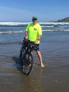 John Sweeney dipped his bike in the Pacific Ocean at the trip's start.