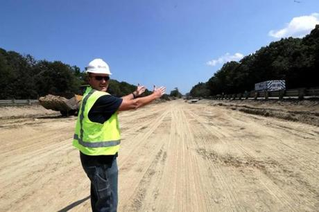 Hanover, MA - 8/01/2017 - Manny Aguiar, Resident Engineer, Mass DOT standing in the area under construction between Route 3 north and south bound that will serve as a temporary roadway during construction and that at the conclusion of construction will become a section of the newly realigned road. The State Department of Transportation is undertaking a $30 million project to replace four structurally deficient bridges that carry Route 3 over High Street in Norwell and over Route 123 (Webster Street) in Hanover. - (Barry Chin/Globe Staff), Section: Regional/South Week, Reporter: John Laidler, Topic: 13soroadwork, LOID: 8.3.3256216822.
