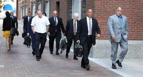 Robert Cafarelli (right) and his lawyer Carmine Lepore led other defendants and attorneys to the courthouse.