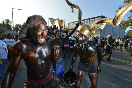 Participants covered in paint, and wearing devils horns as part of the Grenadian tradition of the Jab Jab Family marching in the Jouvert Parade as part of the Caribbean Carnival on Blue Hill Avenue. Josh Reynolds for The Boston Globe (Metro, Allen )