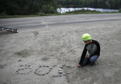 "Katzman's son, Cooper, spelled out ""Go Joe!"" in rocks as he waited with his dad to see McConaughy emerge at Abol Bridge."
