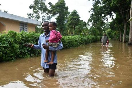 A man walked in a street that was flooded in the city of Fort Liberte, Haiti.