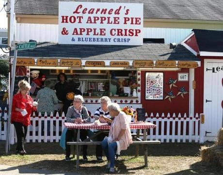 24notopsfield - Owner Tawny Learned delivers a whipped cream topped bowl of hot apple crisp, one of hundreds served during the 11-day Topsfield Fair, to some of her regular customers. (Learned Apple Pie)