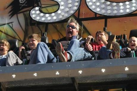 Kevin Maguire, 52, of Marblehead with his sons Casey, left and Jack right, react as they ride the Seven Seas at the Topsfield Fair. Kevin takes his family to the fair yearly and enjoys the same things he's done since he was a boy. Mark Lorenz for the Boston Globe