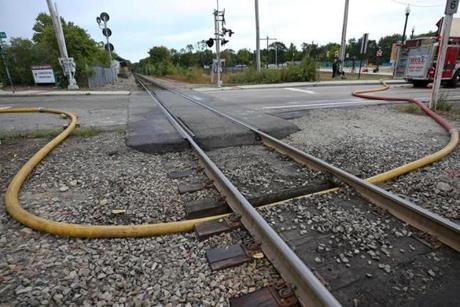 The commuter rail line was reopened after firefighters got hose line dug under the tracks.