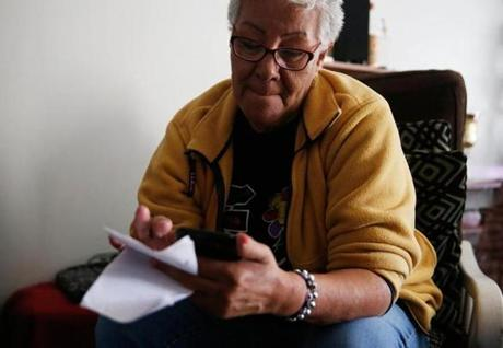 Juliana Perez, 67, tried to call her son Carlos Diaz, 44, who is in Puerto Rico, but she was unable to get a connection to find out if he is OK.