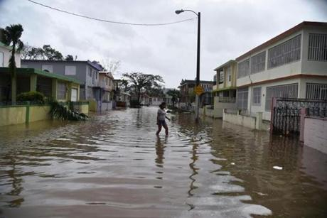 A woman walked through flood water in San Juan, Puerto Rico.