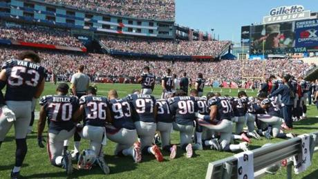 Left to right: Adam Butler, Brandon King, Lawrence Guy, Alan Branch, Jordan Richards, Malcom Brown, Trey Flowers, Deatrich Wise Jr., Duron Harmon, Brandon Bolden, and Elandon Roberts took a knee.