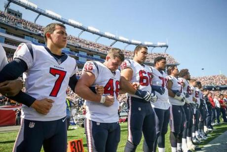 Members of the Texans linked arms before kickoff.