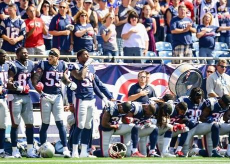 Left to right: David Harris, Dwayne Allen, Cassius Marsh, and Marquis Flowers stand by their teammates.