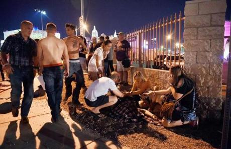 LAS VEGAS SLIDER2 LAS VEGAS, NV - OCTOBER 01: People tend to the wounded outside the festival ground after an apparent shooting on October 1, 2017 in Las Vegas, Nevada. There are reports of an active shooter around the Mandalay Bay Resort and Casino. (Photo by David Becker/Getty Images)