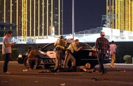 LAS VEGAS, NV - OCTOBER 01: Las Vegas police stand guard along the streets outside the the Route 91 Harvest country music festival grounds after a active shooter was reported on October 1, 2017 in Las Vegas, Nevada. There are reports of an active shooter around the Mandalay Bay Resort and Casino. (Photo by David Becker/Getty Images)