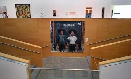 "WELLESLEY, MA - 10/03/2017:The artwork, ""Loading,"" 2011 in the Davis Museum at Wellesley College Flanked by two short staircases, Tim Okamura's double portrait has a small wall all to itself. Seen from across the museum's atrium space, those few square feet look like a promenade, or stage, expressly made for Okamura's two young women. (David L Ryan/Globe Staff ) SECTION: ARTS TOPIC 15views"