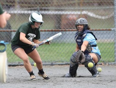 Abington, MA april 14 2019 ......Abington HS softball team at practice...keying on a couple of individuals....for SPORTS....( George Rizer for the Globe) ..LAUREN KELEHER....SLAPS DOWN A BUNT DURING BP..