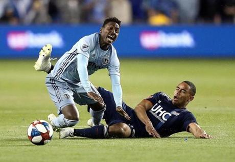 KANSAS CITY, KANSAS - APRIL 27: Brandon Bye #15 of New England Revolution takes down Gerso #12 of Sporting Kansas City resulting in a red card ejection for Bye during the game at Children's Mercy Park on April 27, 2019 in Kansas City, Kansas. (Photo by Jamie Squire/Getty Images)