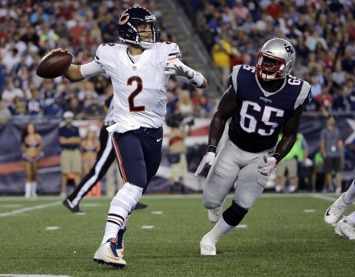 62260690b35 Chicago Bears quarterback Brian Hoyer (2) rolls out to pass under pressure  from New