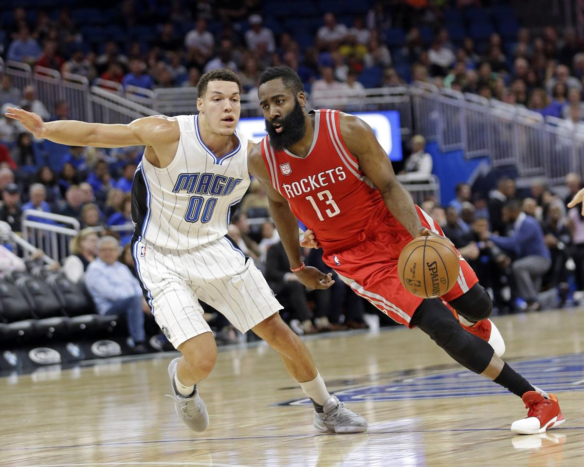 Houston Rockets  James Harden (13) drives around Orlando Magic s Aaron  Gordon (00 96501a0fc