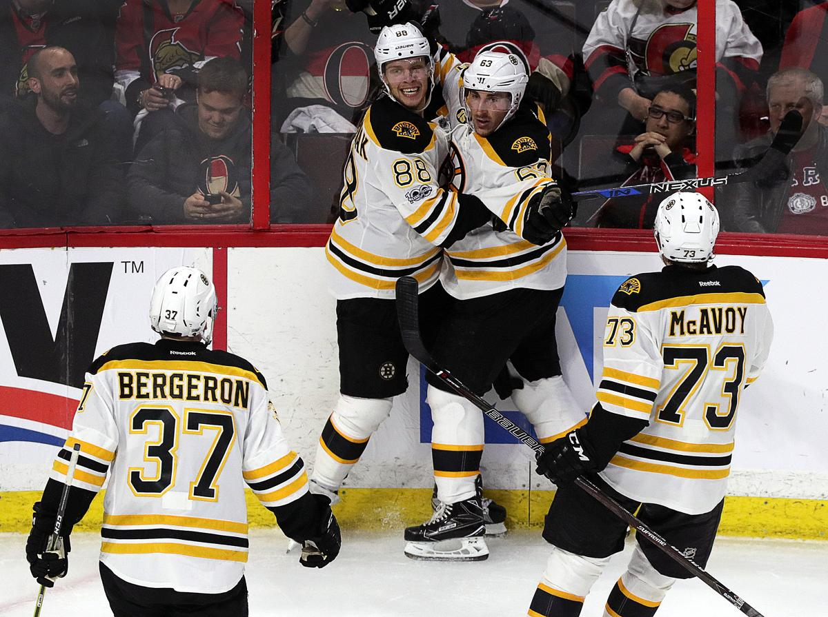 bef873e8f9e Brad Marchand s late goal lifts Bruins in Game 1