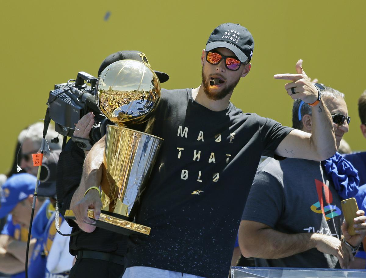 e8909a40616 Stephen Curry points to the Larry O Brien trophy during the Golden State  Warriors NBA