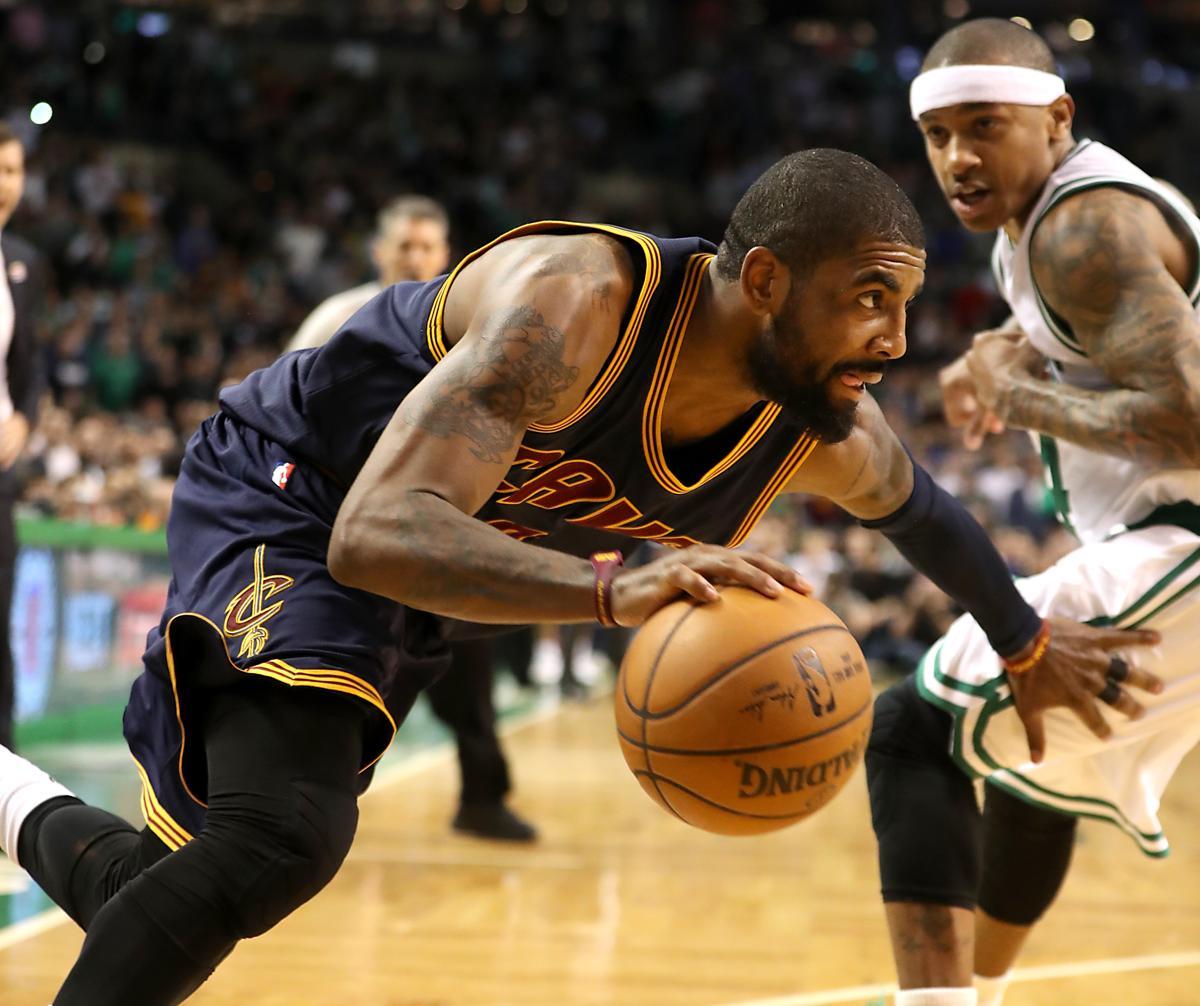 Boston MA 3/1/17 Cleveland Cavaliers Kyrie Irving drives past Boston Celtics  Isaiah