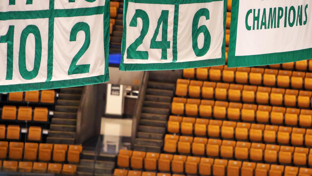 Russell s number is one of 21 retired by the Celtics and hanging from the ceiling  at 0324d6fec