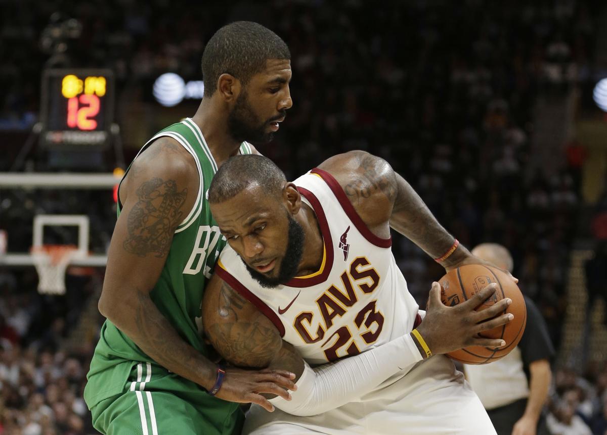 Cleveland Cavaliers\u0027 LeBron James, right, tries to get past Boston Celtics\u0027  Kyrie