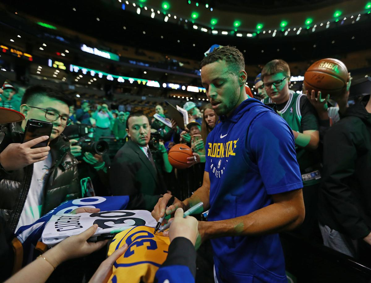 0d1151164a27 Stephen Curry surprises Boston high school basketball team with sneakers