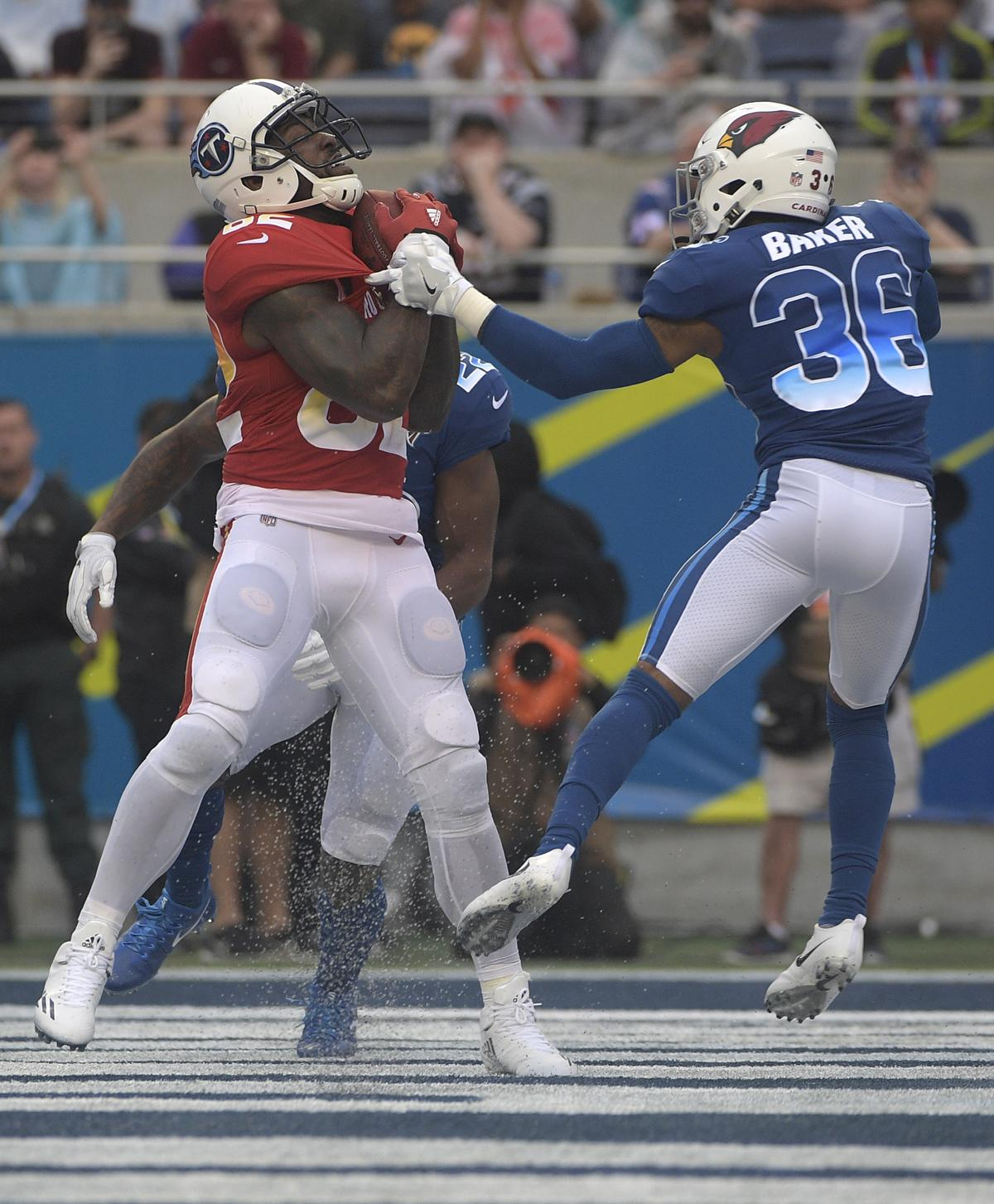 81bcce0b1 AFC tight end Delanie Walker hauls in a TD over the NFC s Budda Baker.