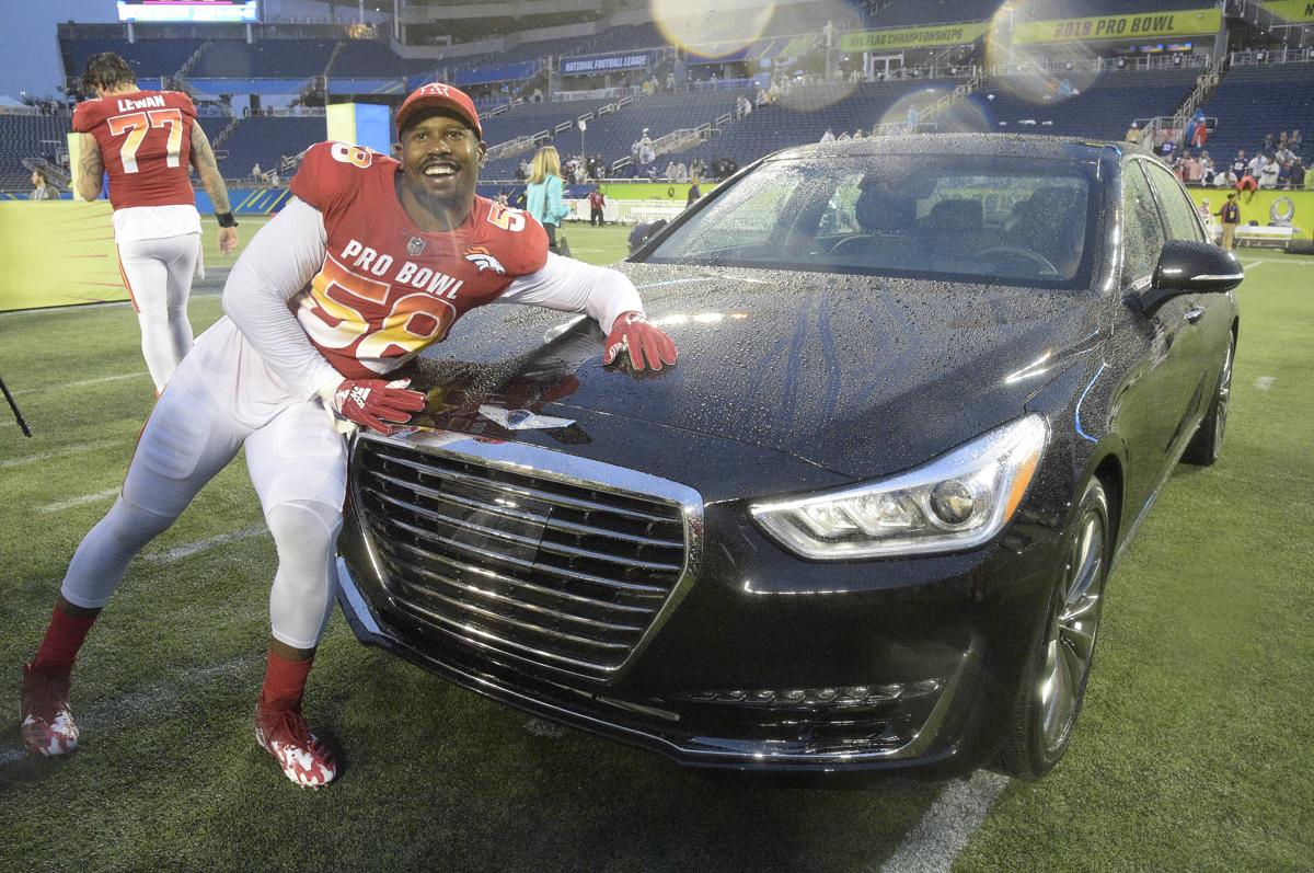 6f9d3f674 AFC linebacker Von Miller poses with a car he won for being the defensive  MVP.