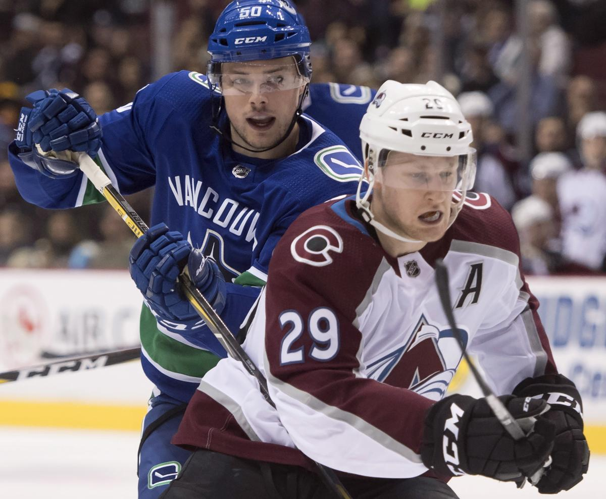 Colorado's Nathan MacKinnon (29) will miss up to a month after a collision  against