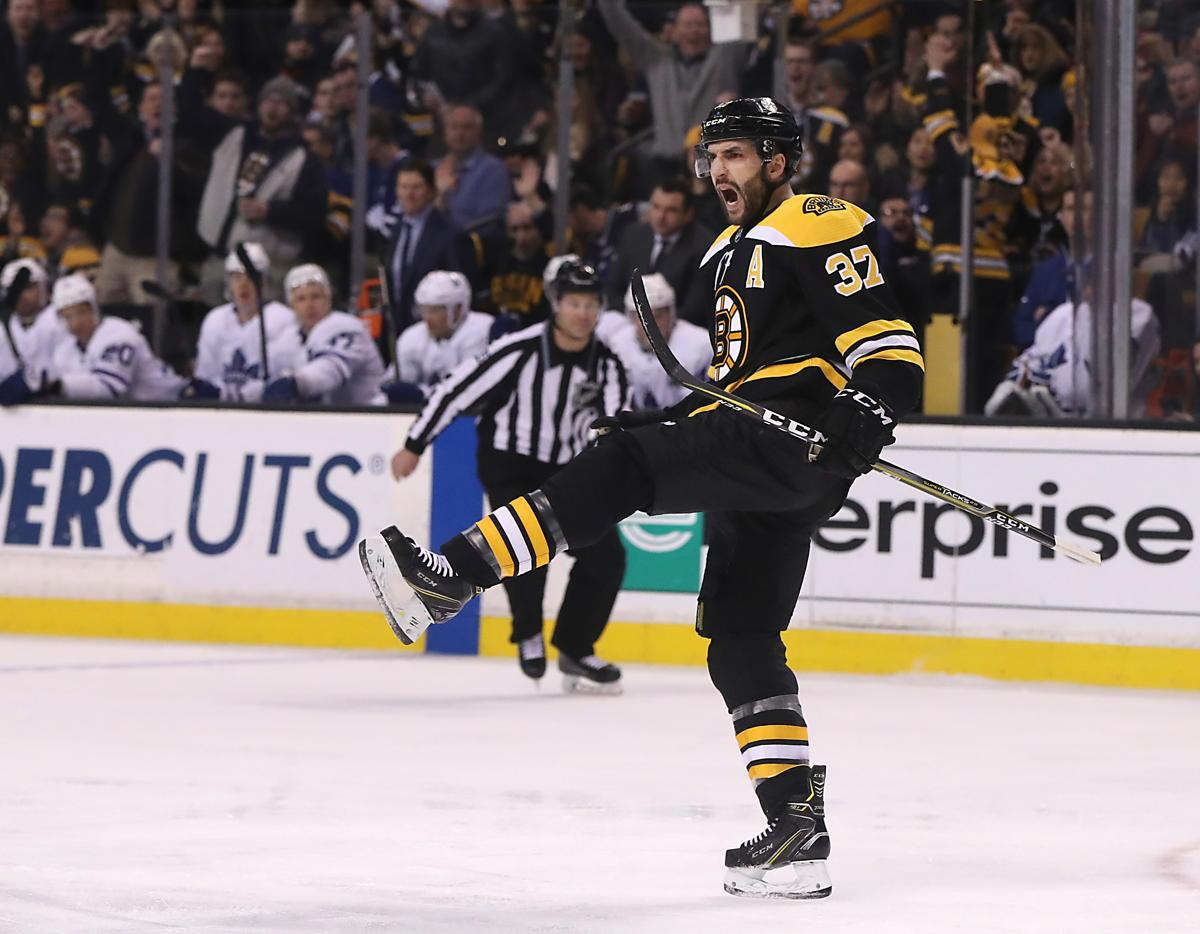 Boston MA 02/03/18 Boston Bruins center Patrice Bergeron (37) celebrates his goal against the Toronto Maple Leafs during first period action at TD Garden. (Matthew J. Lee/Globe staff) topic: reporter: