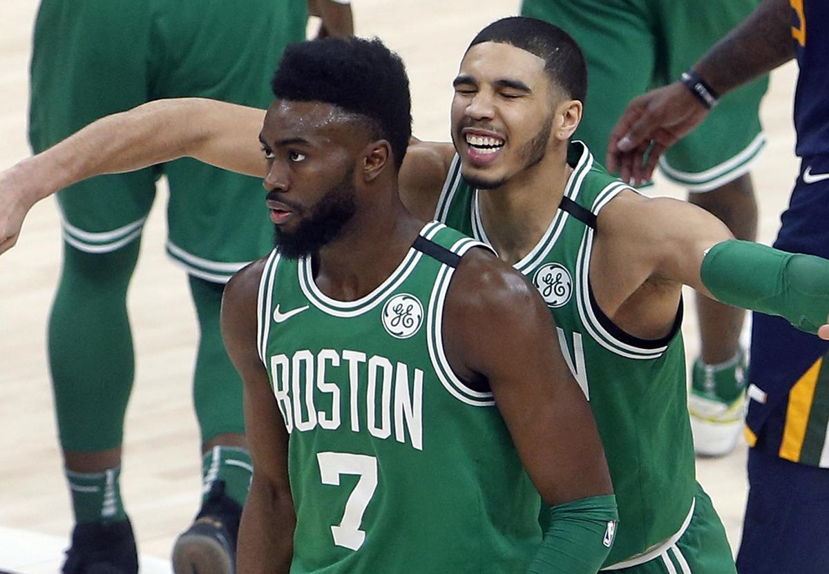 boston celtics jayson tatum rear hugs jaylen brown 7 after brown