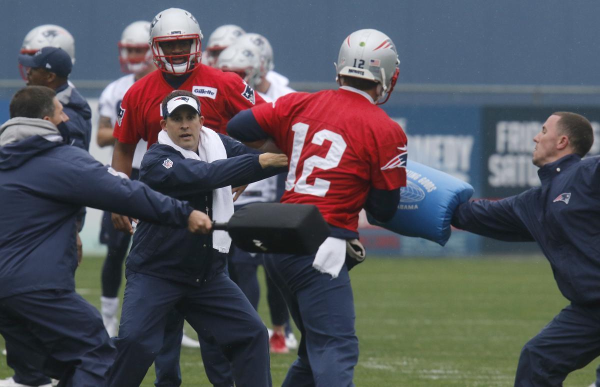 New England Patriots quarterback Tom Brady (12) runs through a drill with  offensive coordinator bcf98d380