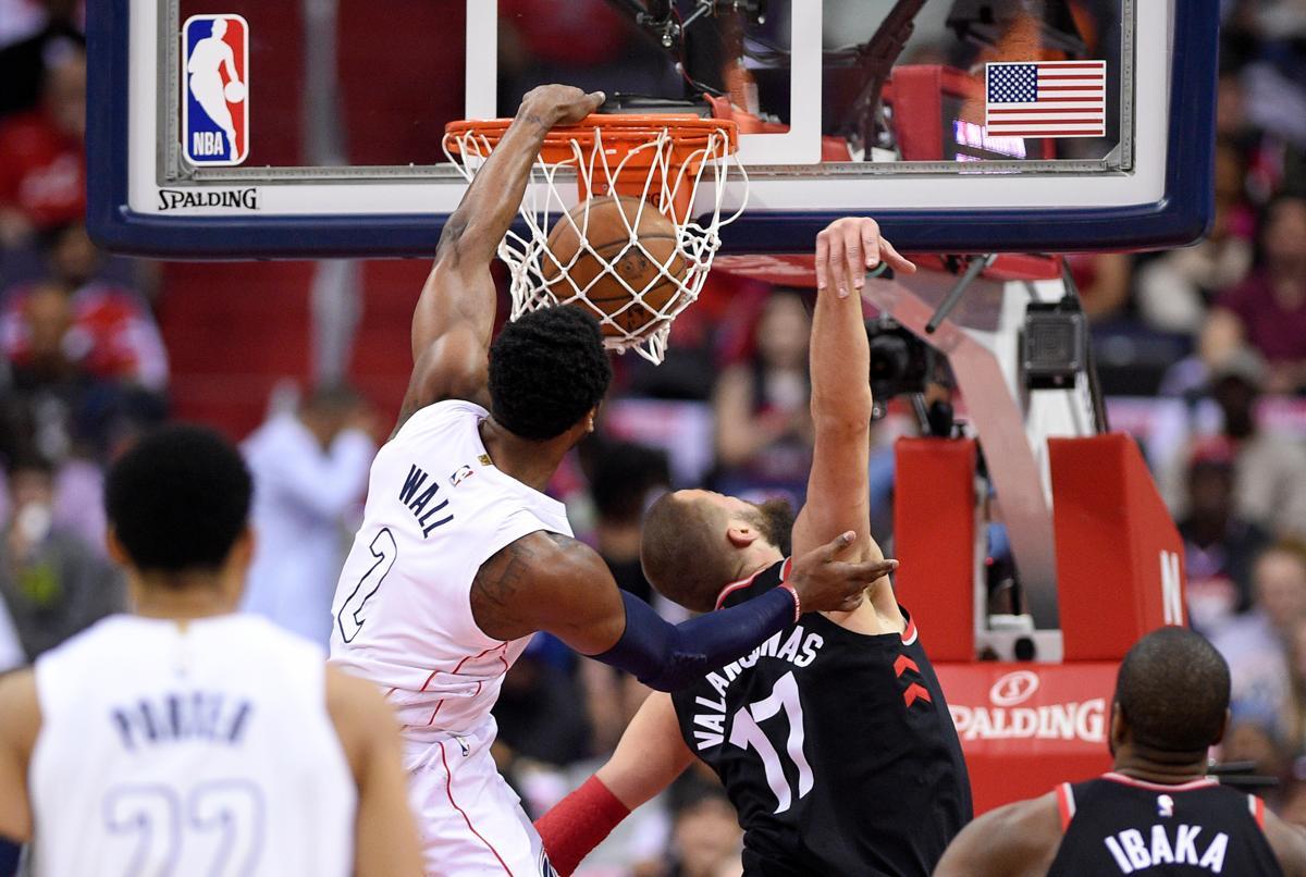 Washington Wizards Guard John Wall 2 Dunks Against Toronto Raptors Center Jonas Valanciunas