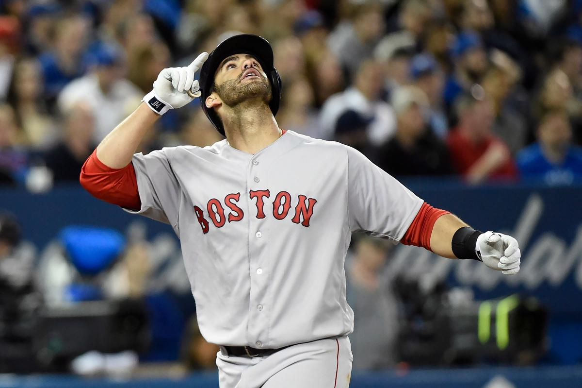 Boston Red Sox s J.D. Martinez reacts after hitting a three-run home run  against the 1e70981c6