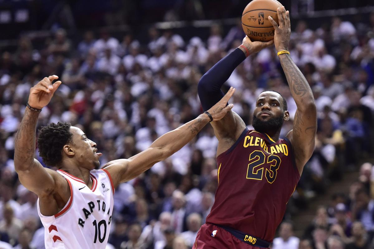 65163082bb4c Cleveland Cavaliers forward LeBron James (23) shoots over Toronto Raptors  guard DeMar DeRozan (