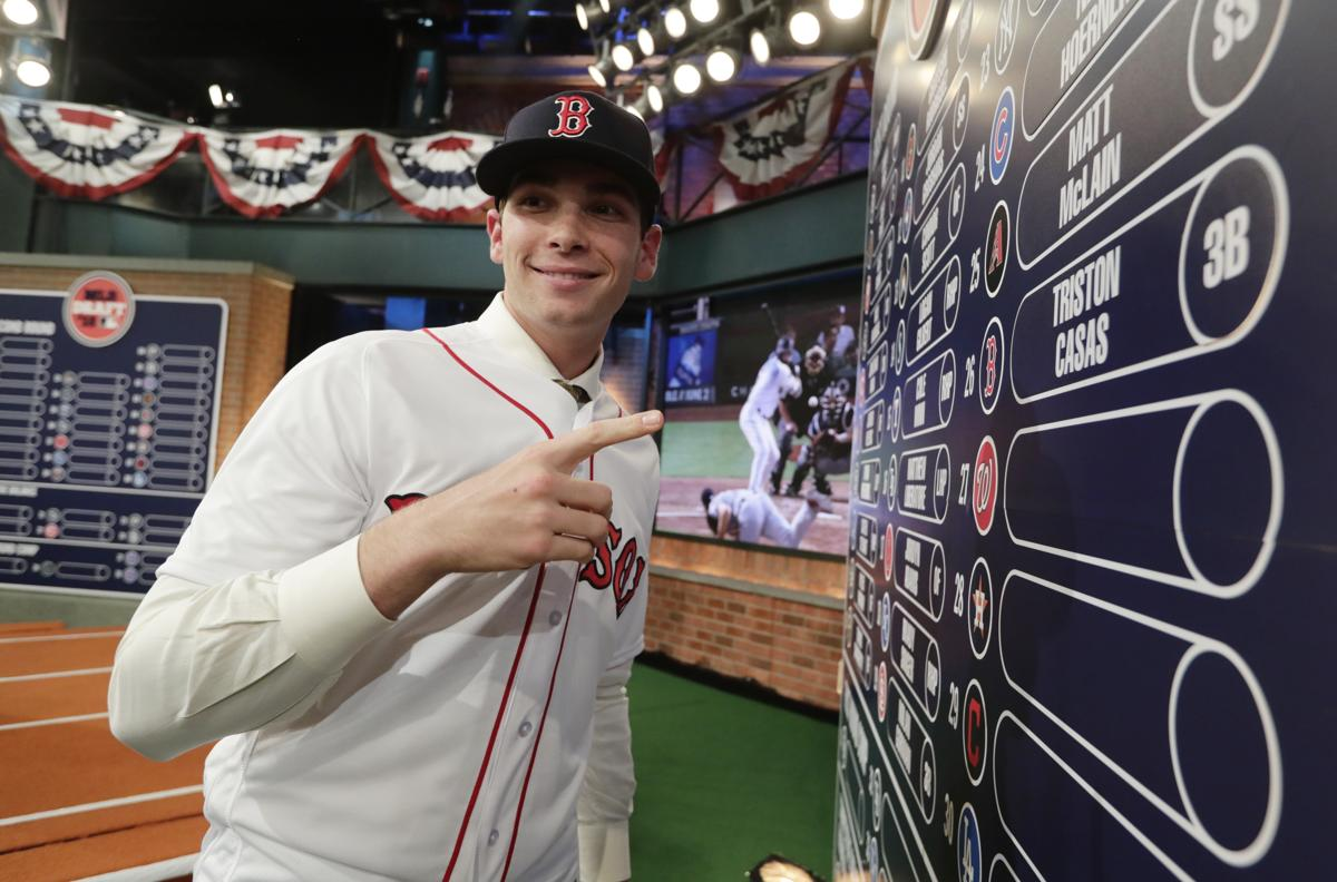 c1867dec0 Boston Red Sox  Triston Casas poses for photographs after being selected  26th during the first