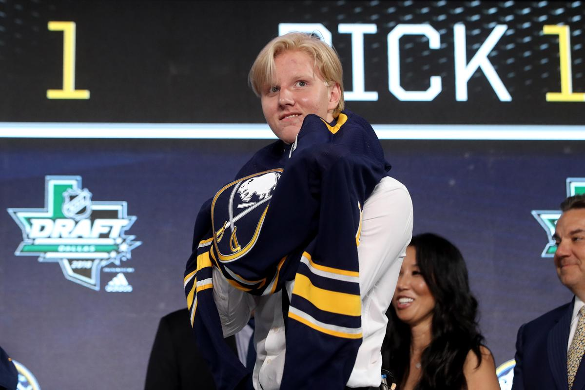 3142fce3e Dallas june rasmus dahlin celebrates after being selected first overall rasmus  dahlin pulls a sabres jersey
